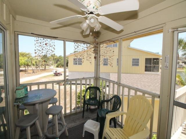 Furniture,Chair,Ceiling Fan,Table,Porch