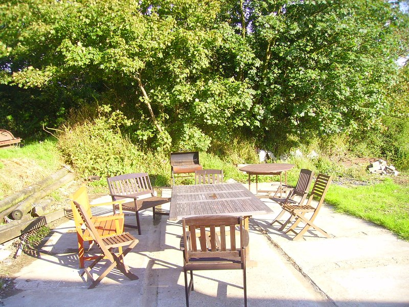 Patio & BBQ area outside with plenty of space and extra plastic chairs inside The Barn if required