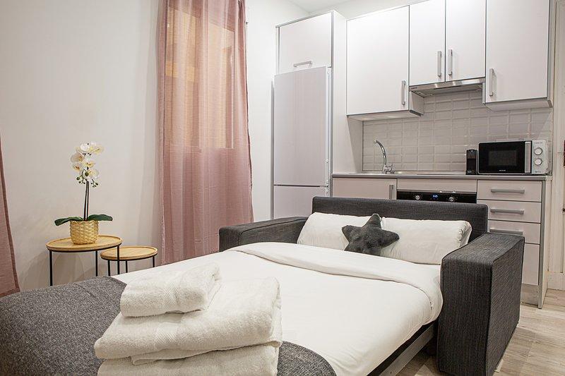 Sofá-cama duplo na sala
