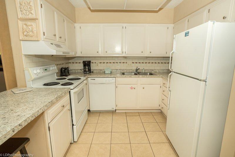 Flooring,Indoors,Room,Refrigerator,Kitchen