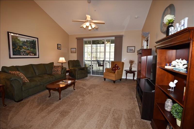 Flooring,Furniture,Table,Couch,Ceiling Fan