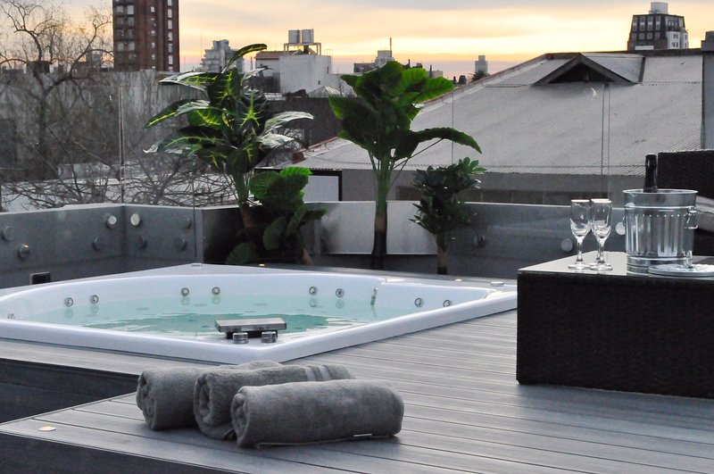 Enjoy a glass of champagne while sitting in our private rooftop Jacuzzi.