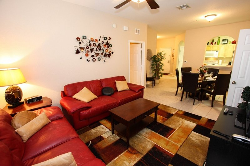 Comfortable Living Area w/Flat Screen TV and Private Balcony Access
