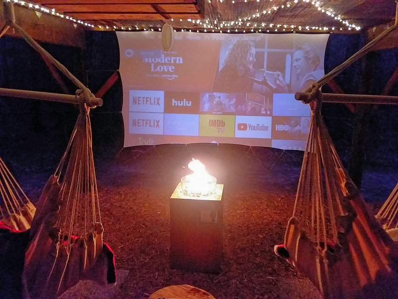Hammock chairs, firepit, and a big screen in the outdoor theater. Nighttime, March thru  December.