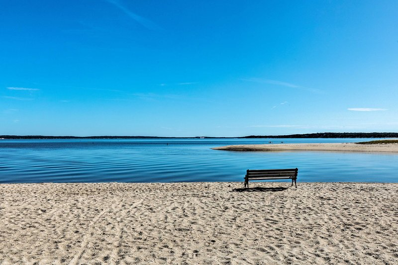 Sit along the calm waters by the beach just down the road!
