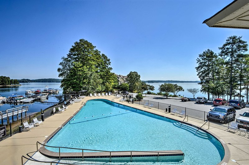 The community pool boasts panoramic lake views.