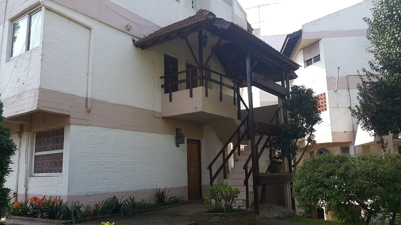 Contrafrente with access staircase to the department