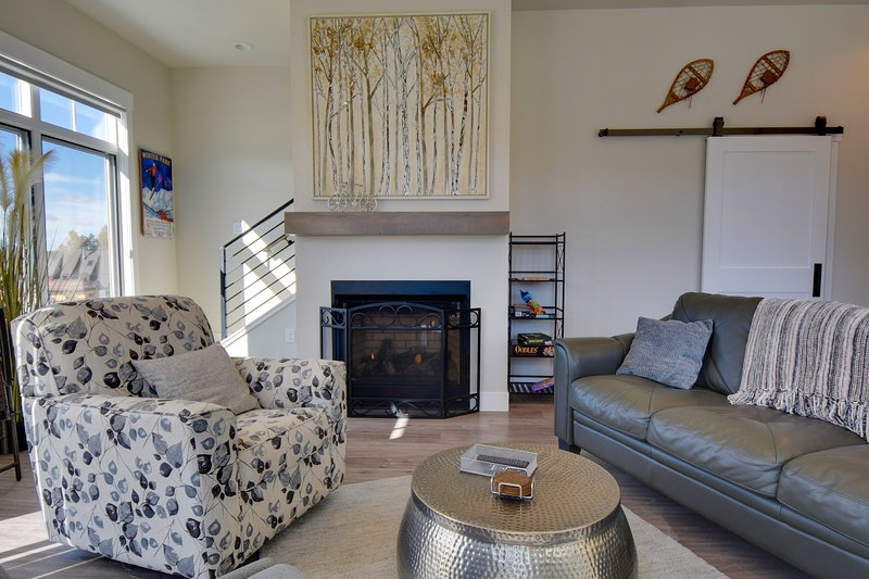 Living area with comfy seating and a gas fireplace