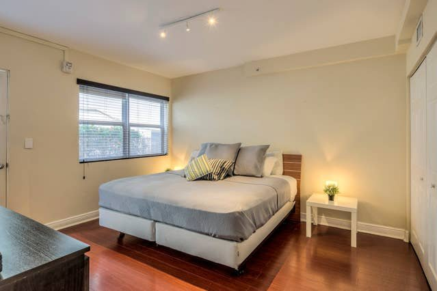 Bedroom: king size bed, interior details, large wardrobe, Smart TV, air conditioner(A/C).