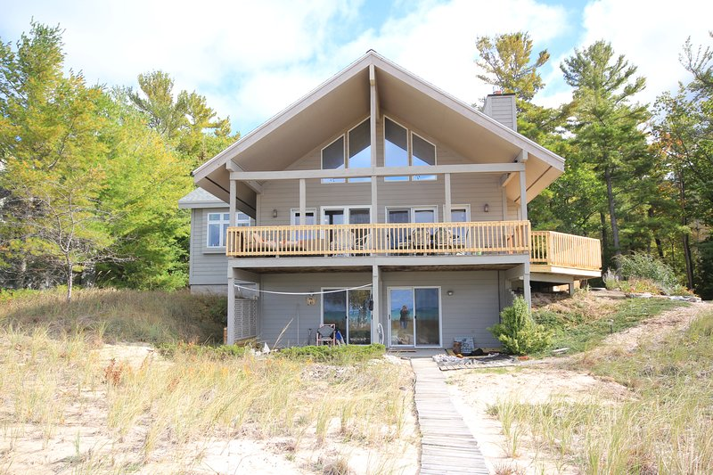 Front of the house (water side), view of the deck  (upper), beach room, and bedroom 4 walk out.