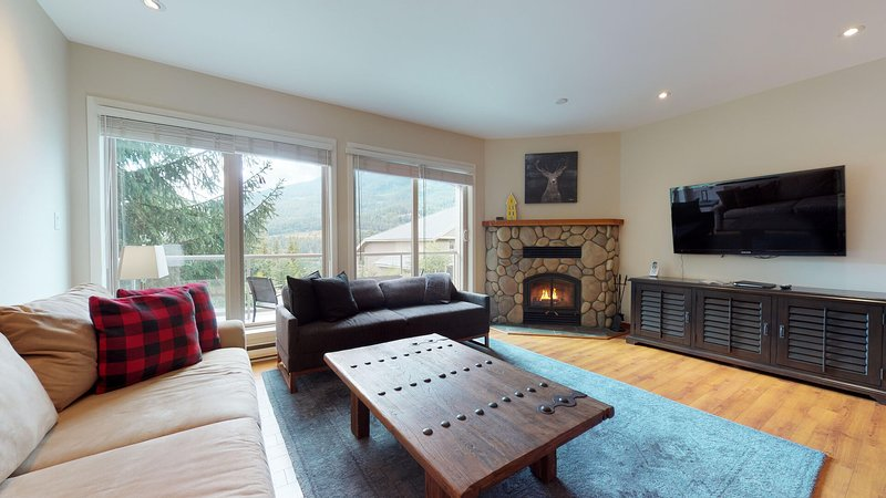 Bright and spacious living area complete with a wood burning fireplace for the colder winter months