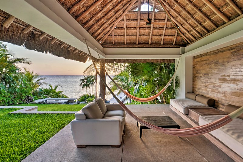 Sit by the Carribbean Sea at this 4-bedroom, 6.5-bath home!