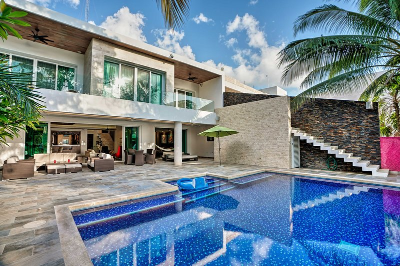 Perfect your tan by the lavish pool at this vacation rental!