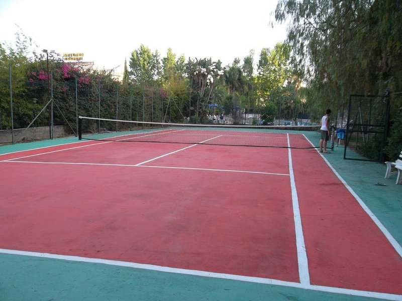 Shared tennis court inside the complex