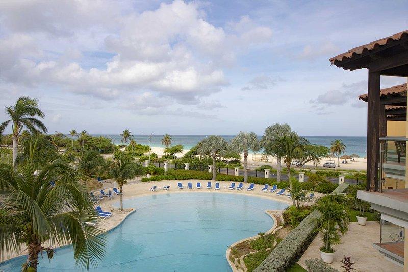 BEACHFRONT- EAGLE BEACH - OCEANIA RESORT - Deluxe View 1BR condo - E323-2, holiday rental in Palm - Eagle Beach