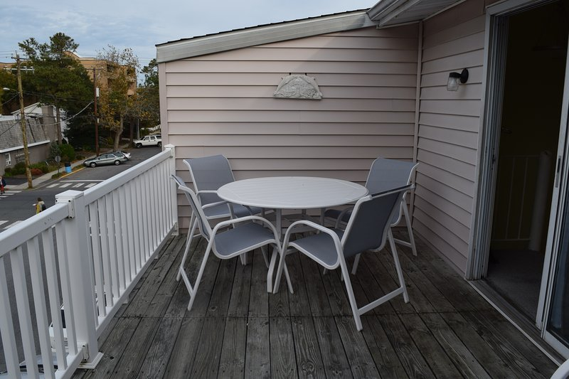 Table and chairs outside on the upper deck to enjoy the summer breeze!