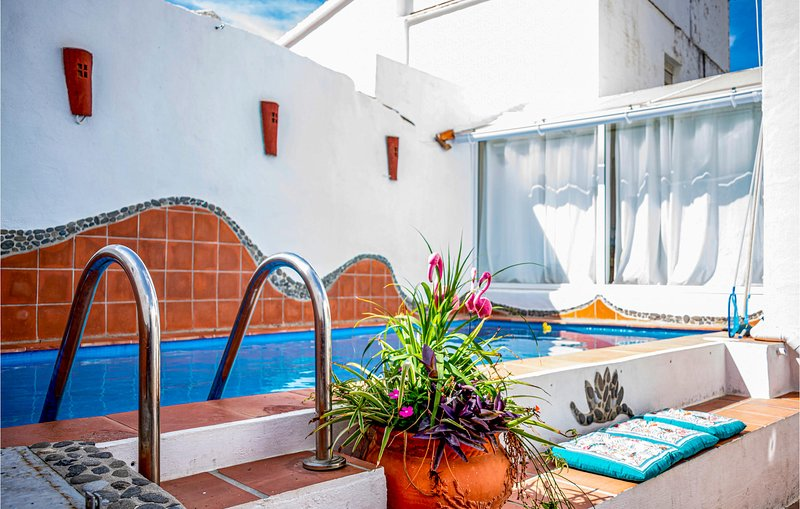 Nice home in Sayalonga with Outdoor swimming pool, WiFi and 4 Bedrooms (EAS338), holiday rental in Sayalonga