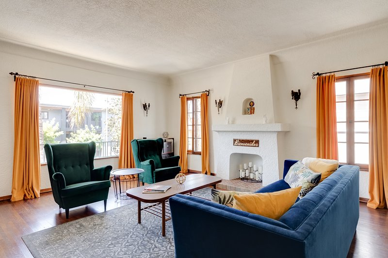 Soak up the natural light in the spacious living room with ample seating for five adults.