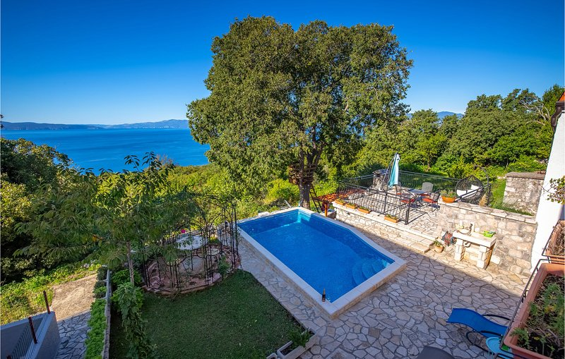 Awesome home in Kostrena with Outdoor swimming pool and 4 Bedrooms (CKA260), holiday rental in Kostrena