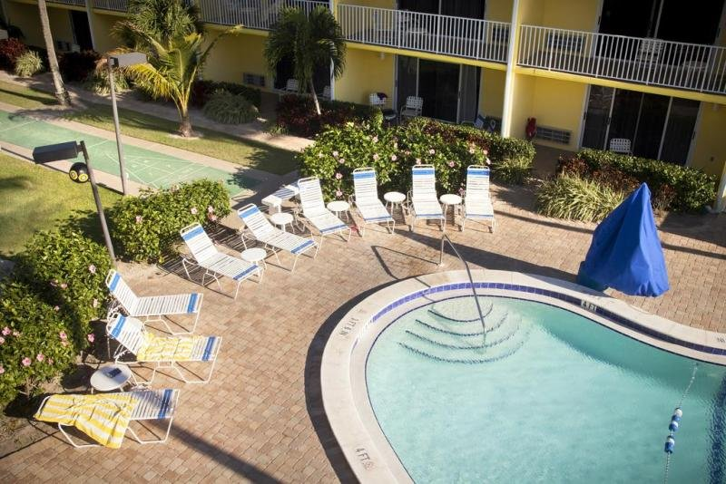 Large heated swimming pool and poolside loungers