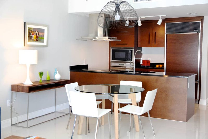 Integrated dining and kitchen area with plenty of light.