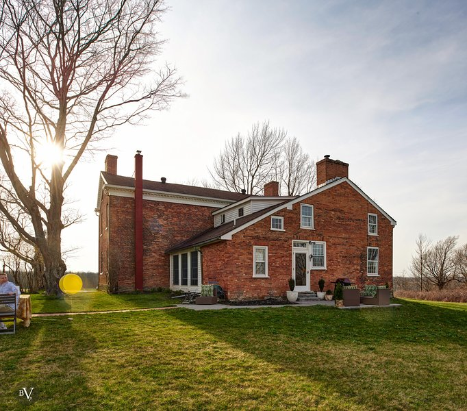 The house is situated on 4 acres overlooking a hundred acres of farmland.