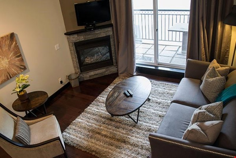 Relax and unwind in the spacious living area, complete with fireplace and flatscreen TV.