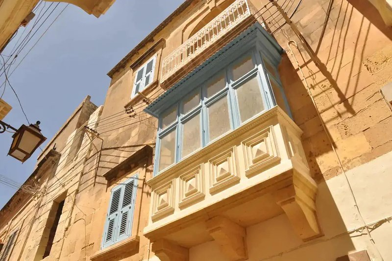 Traditional Timber closed balcony overlooking pedestrian street.