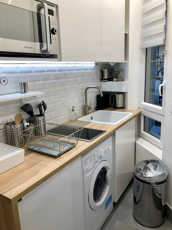 - Fridge, Nespresso machine, microwave oven, toaster, kettle, ceramic hob, vacuum cleaner, USB sock