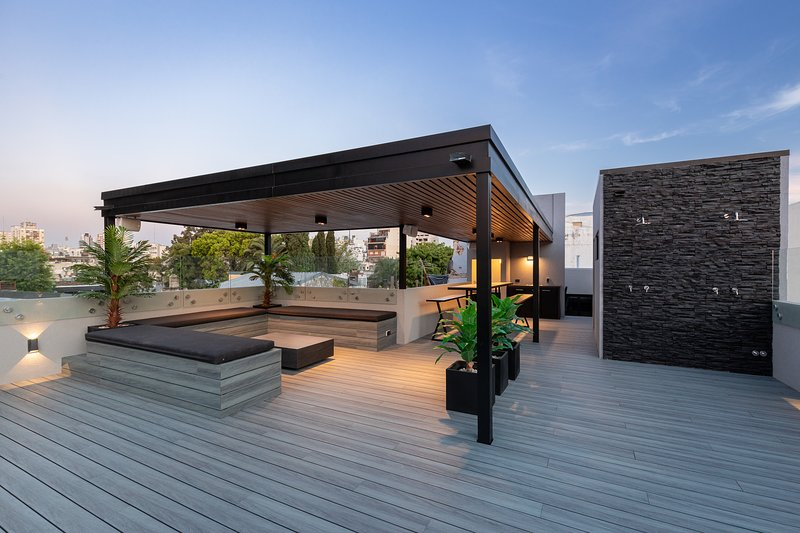 Outdoor lounge with the best in lighting featured here..