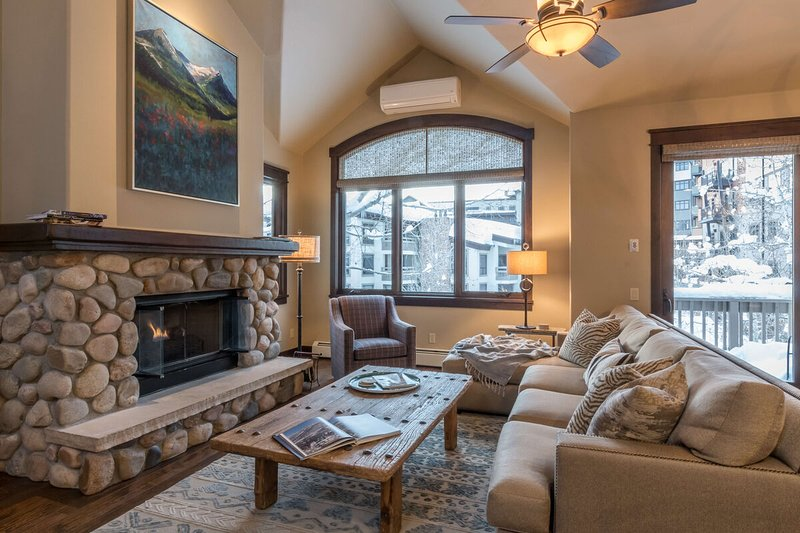 Main level lounge with gas fireplace and cozy seating (upper level)