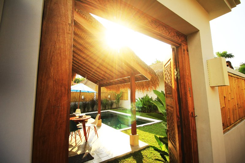 Wooden carved balinese door to welcome you