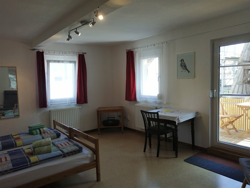 Room with satellite TV, radio, table, chairs, armchairs and balcony