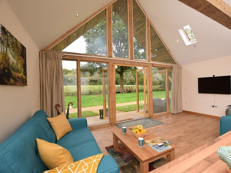 Cosy lounge with breath-taking views through the large apex windows