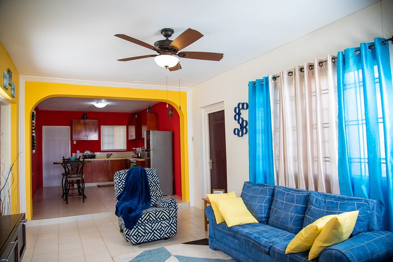 Cozy living room with ceiling fan to keep you cool