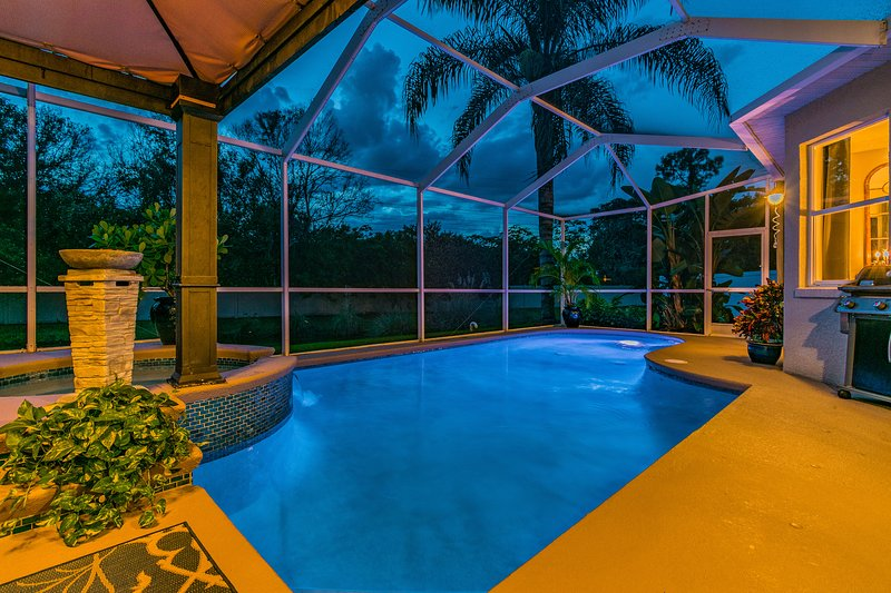 Unwind in the Pool or Hot Tub while the Sun Sets Over The Treetops.