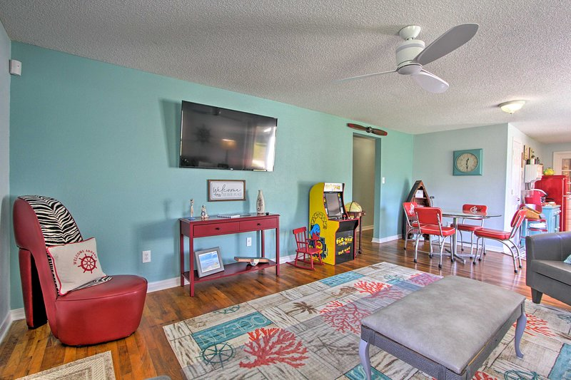 Unwind in colorful comfort at this Pensacola vacation rental house!