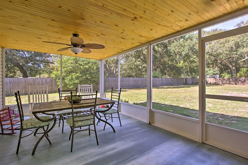 The bright, open home features a spacious lanai and yard.