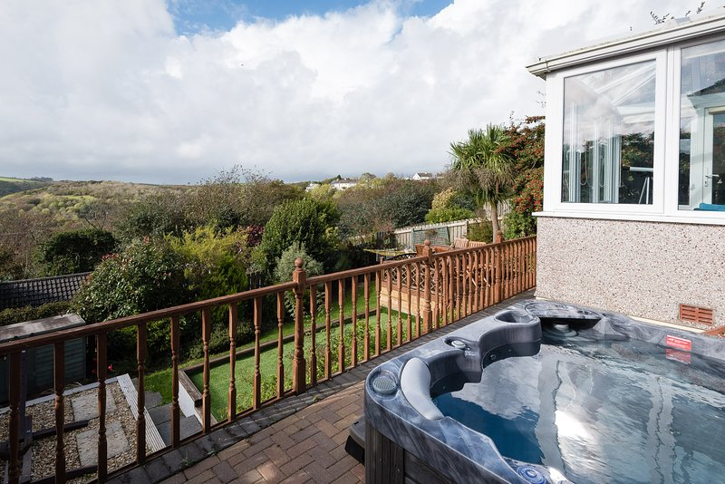 The second patio houses the hot tub and sun loungers - a perfect place to relax!