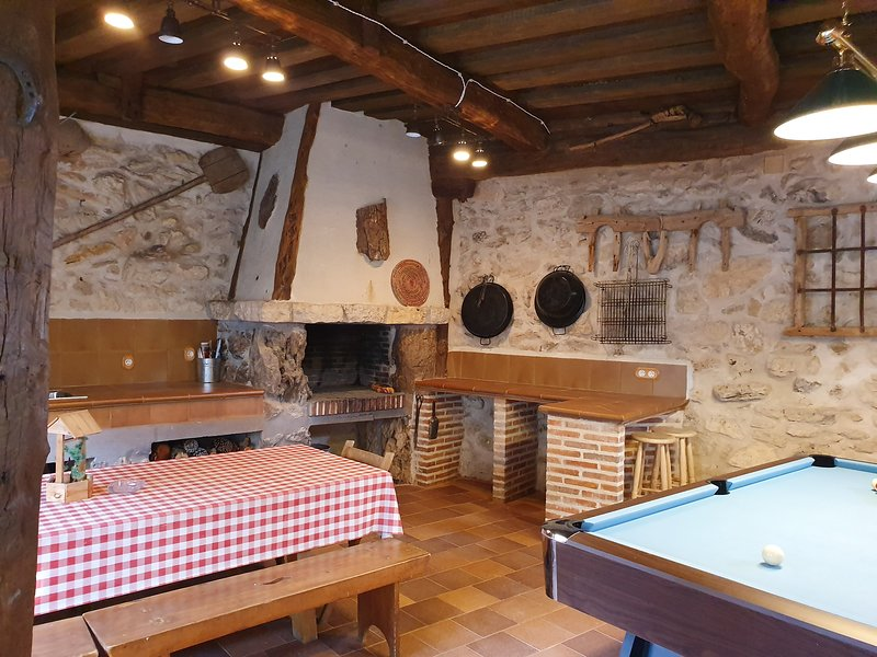 Multipurpose room with barbecue, billiards, table football and target.
