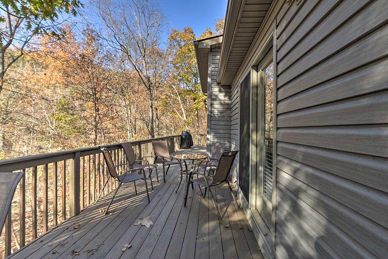 The home's wraparound porch shrouded in lush foliage.
