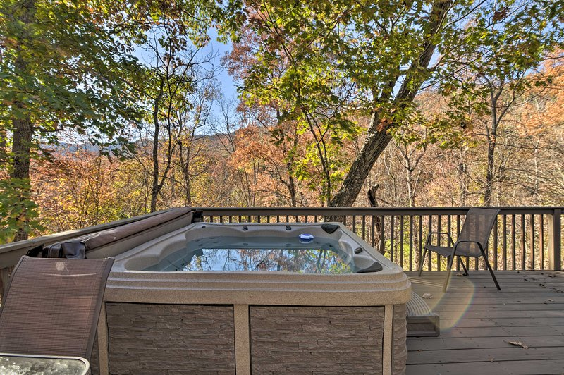 Soak in the private hot tub when you stay at this spacious vacation rental!