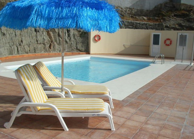 Filin 7, Luxury apartment, 2 bedrooms, 2 bathrooms, heated pool, Wi-Fi and UK TV, alquiler vacacional en Gran Canaria