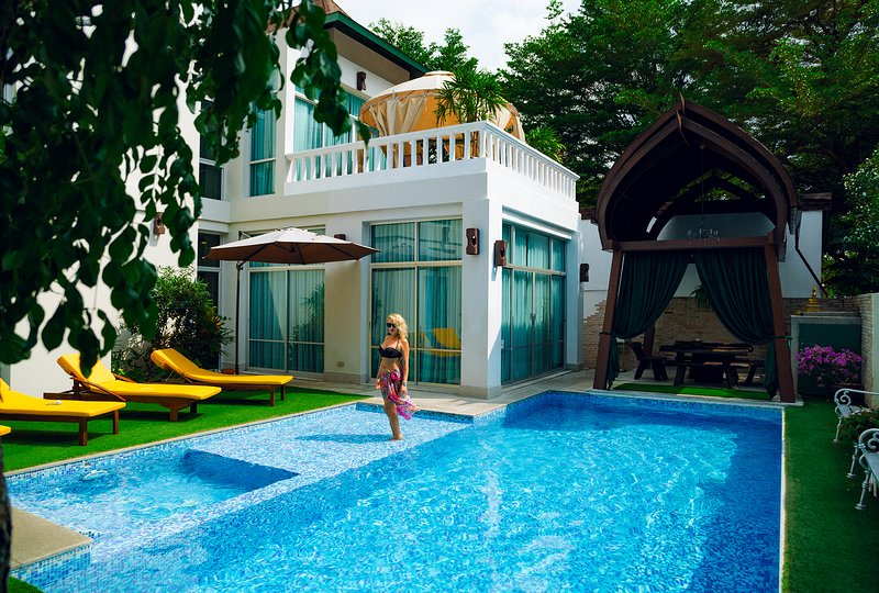 Big private swimming pool with kid section and patio at backyard of Villa