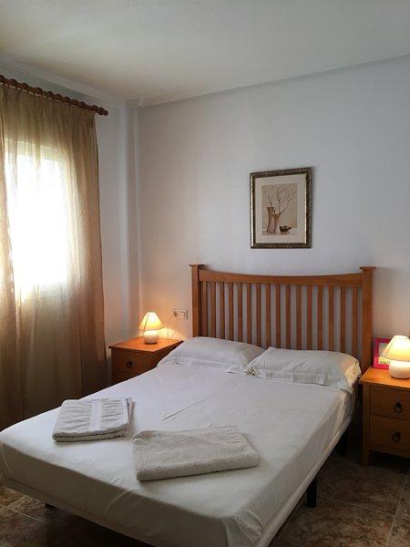 2 bed 2 bath townhouse on  La Cinuelica, R14 overlooking communal pool DC053, holiday rental in Punta Prima