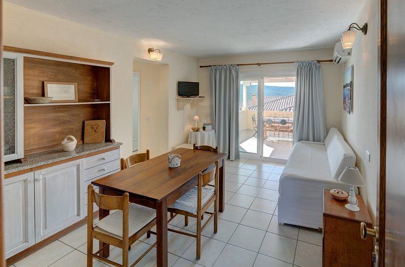 Appartamento Bilocale 4 persone - Baia de Bahas Residence, vacation rental in Marinella