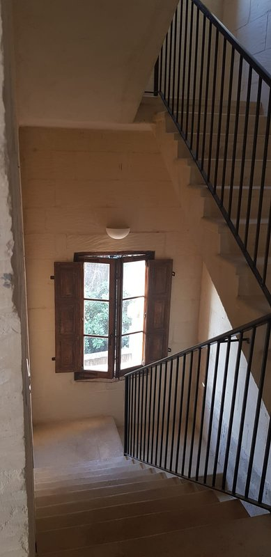 Stairwell leading to bedrooms