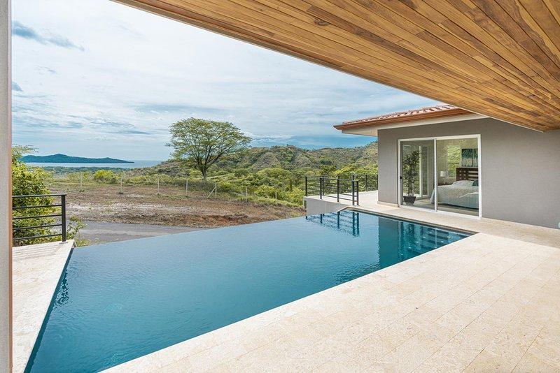 Refreshing infinity edge pool, ocean views