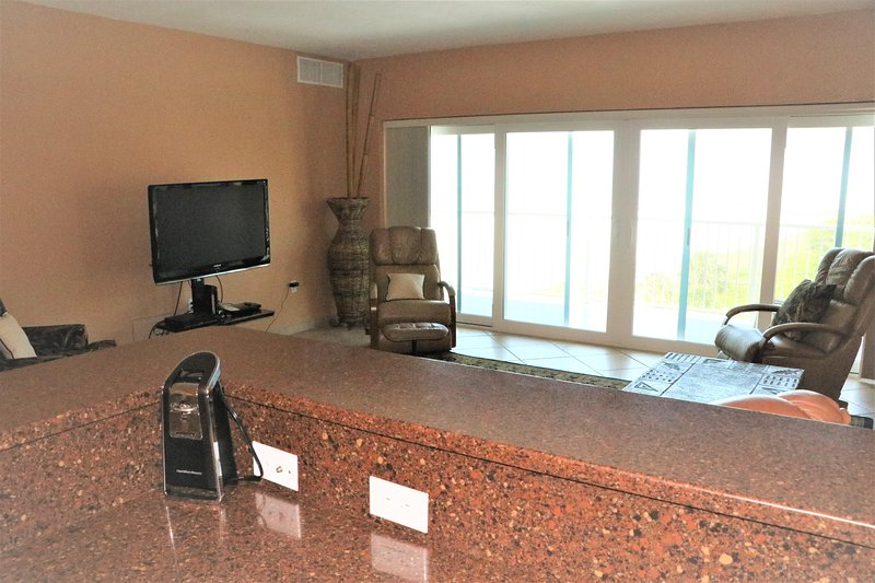 Flooring,Screen,Furniture,Entertainment Center,Chair