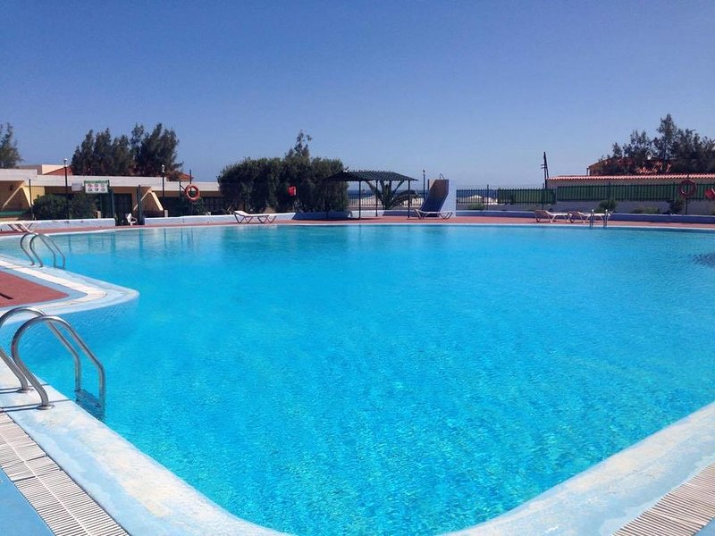 Beautiful apt with pool access, vacation rental in Nuevo Horizonte
